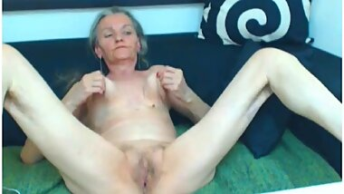 Sexy granny on cam gets naked