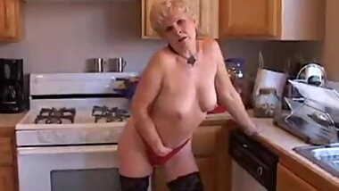 Sexy granny in the kitchen