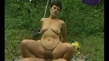 Mature porn star Ibolya gets fucked good in nature.