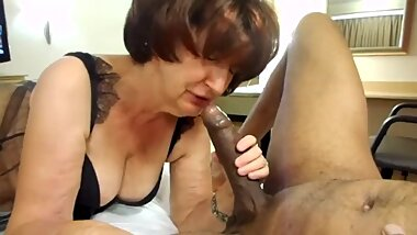 Granny loves sucking on a big black young cock